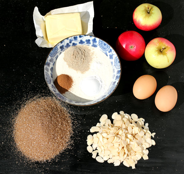 Ingredients - apples, eggs, butter, brown sugar, almonds, flour, cinnamon, cardamom and baking powder