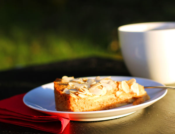 A piece of the Swedish Apple Cake with a mug